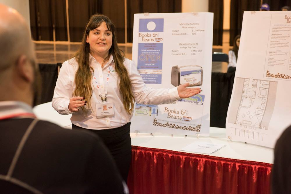 A ProStart student explaining her management presentation to the judges at the ProStart competition